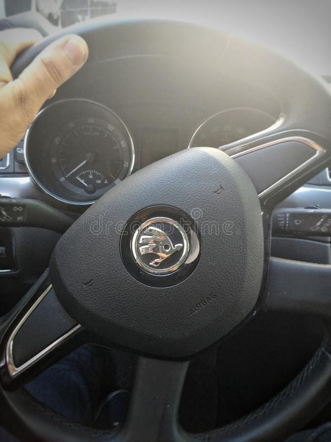 Skoda car wheel. Man hand on Skoda car wheel with blur outside stock photos