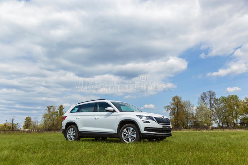 Skoda Kodiaq 2.0 TDi Style. Ukraine Kyiv 25 April 2017 car Skoda Kodiaq 2.0 TDi model year 2017 car in the field on a background sectional sky stock photos
