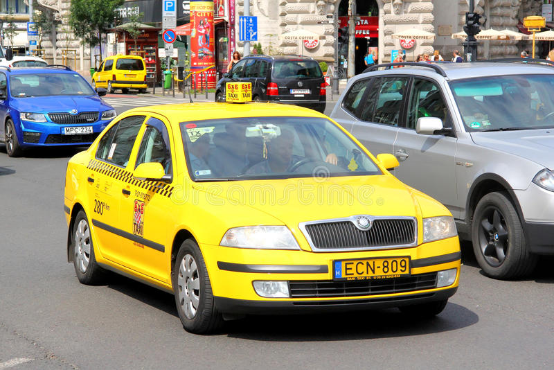 Skoda Octavia. BUDAPEST, HUNGARY - JULY 23, 2014: Yellow taxi car Skoda Octavia at the city street stock photos