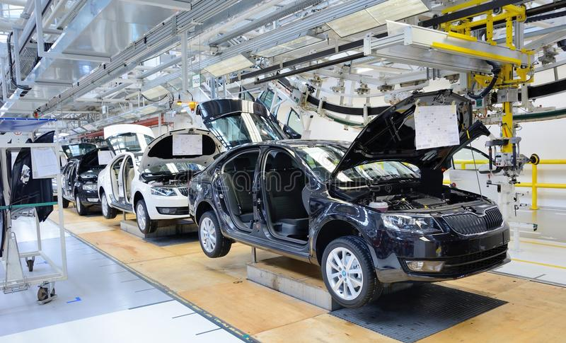 Skoda Octavia on conveyor line in factory. MLADA BOLESLAV, CZECH REPUBLIC - MAY 30: Skoda Octavia on conveyor line during Doors Open Day at Skoda Auto a.s royalty free stock images