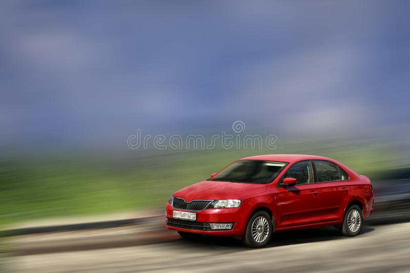 Skoda red car. Skoda red car on blurred in motion background stock photography