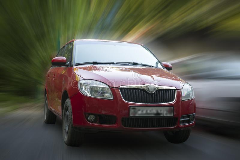 Skoda red car. Skoda red car on blurred in motion background stock photos