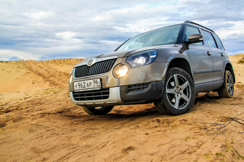Skoda Yeti. NOVYY URENGOY, RUSSIA - SEPTEMBER 5, 2015: Motor car Skoda Yeti at the sand desert royalty free stock images