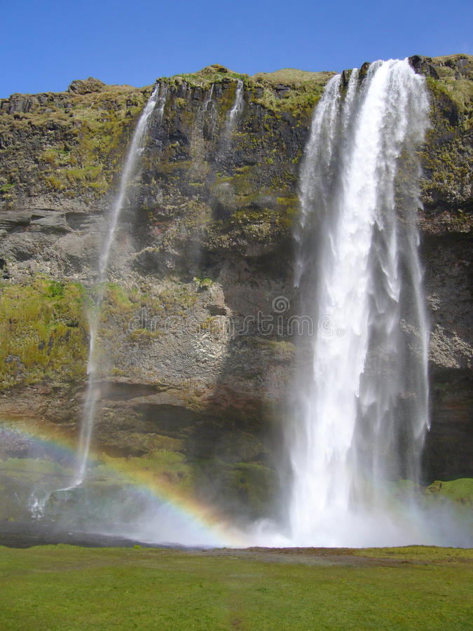Skogafoss waterfall with rainbow, Iceland stock photography