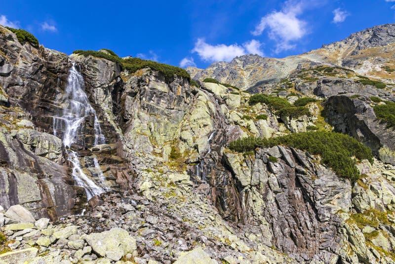 Skok waterfall in High Tatras Mountains Vysoke Tatry, Slovakia. Hiking in High Tatras Mountains Vysoke Tatry, Slovakia. Skok waterfall Slovak: Vodopad Skok stock photo