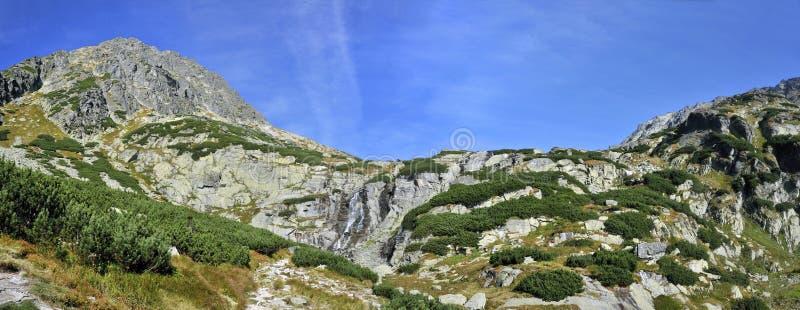Vodopad Skok, Mlynicka dolina, Vysoke Tatry, Slovakia. Skok waterfall and Strbske Solisko peak in Mlynicka valley in High Tatras mountains - Slovakia stock images