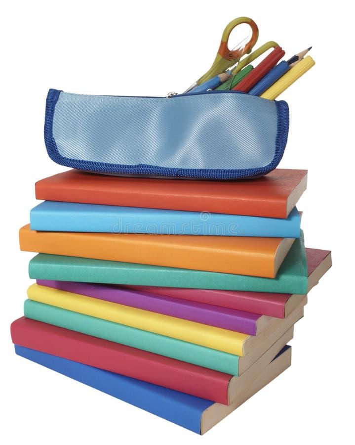 skola för blyertspenna för utbildning för bokfall arkivfoton