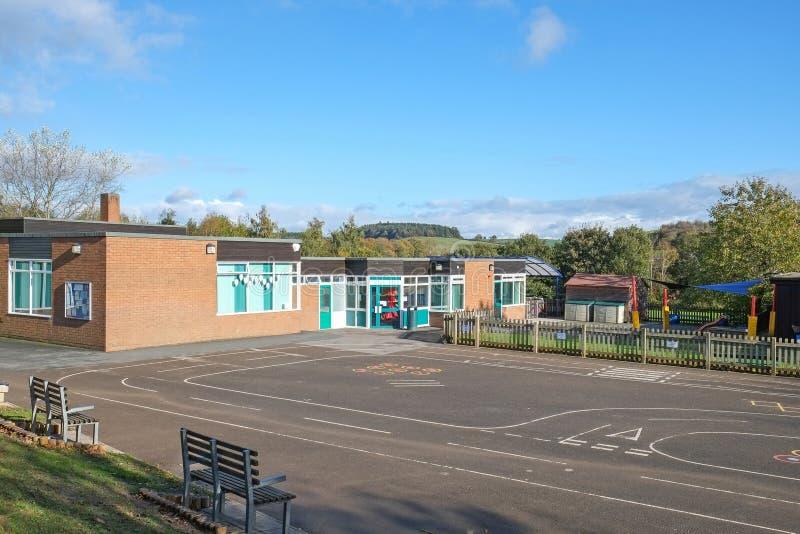 Skolabyggnad, begynnande/junior UK - 5-11years royaltyfri foto