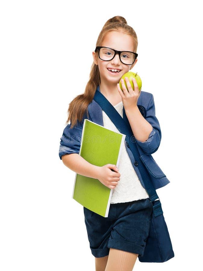 Skolbarn, flicka i exponeringsglas med boken och Apple, student Kid royaltyfri foto