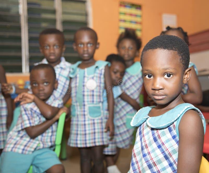 Skolbarn fr?n Ghana, V?stafrika arkivfoto