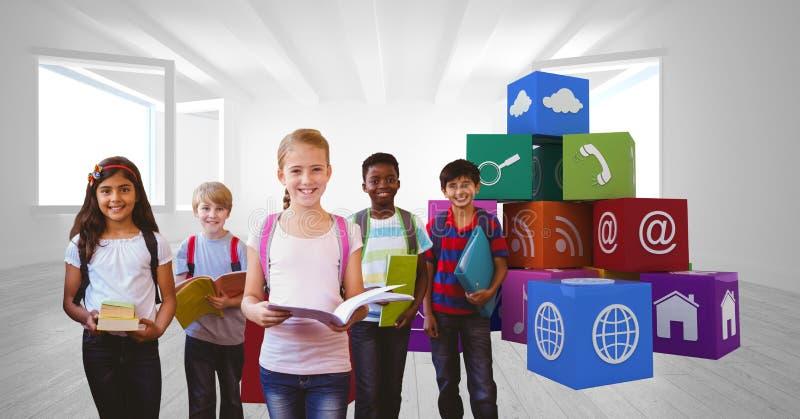 Skolbarn som rymmer böcker vid app-symboler royaltyfria bilder