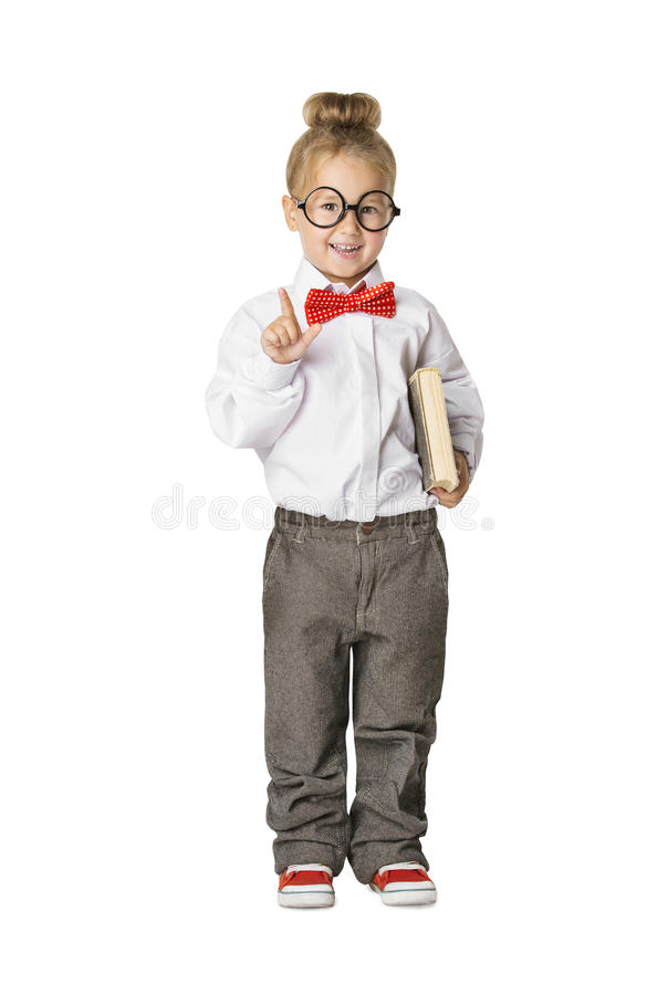 Skolbarnstående, liten skolaflicka i exponeringsglas, ungebok royaltyfria foton