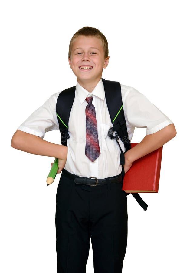 Skolpojke med boken och blyertspennan arkivbild