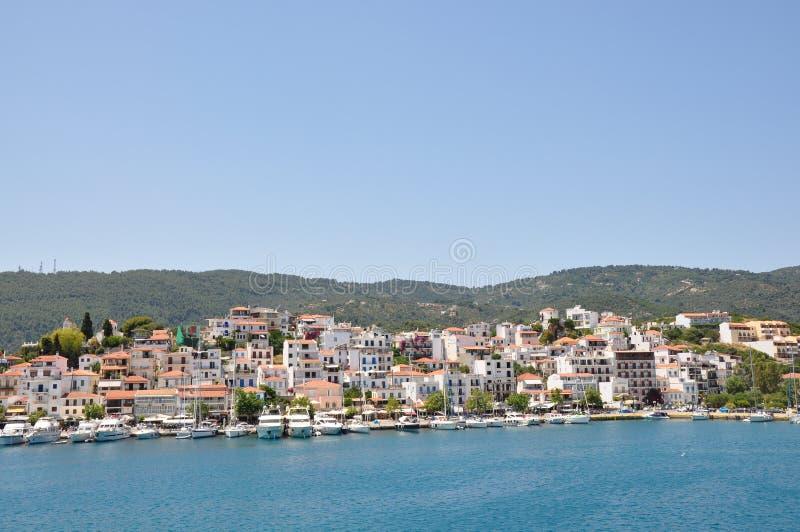 Skopelos island seaside coastline town with buildings, typical greek view stock image