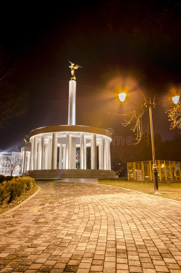Skopje, Macedonia fire torch and marble monument of heroes. Monument of heroes skopje macedonia, night wide shoot paved walking trail stock images