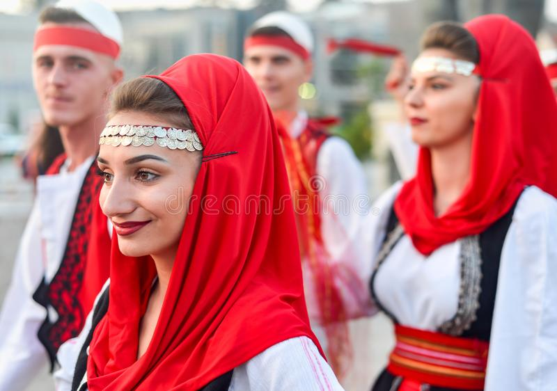 SKOPJE/NORTH MACEDONIA-AUGUST 28 2018. Kosovan performers at Skopje International festival of music and dance.Multi national participants parade across Stone stock photos