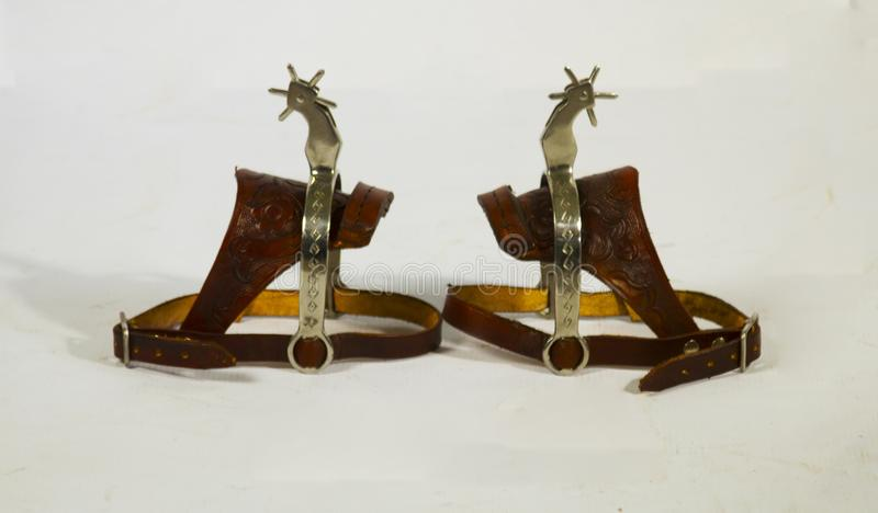 Skor för en sakkunnig som ska tillfogas i hästarna som göras av cowÂs läder och dem, är mycket användbara till någon cowboy arkivfoto