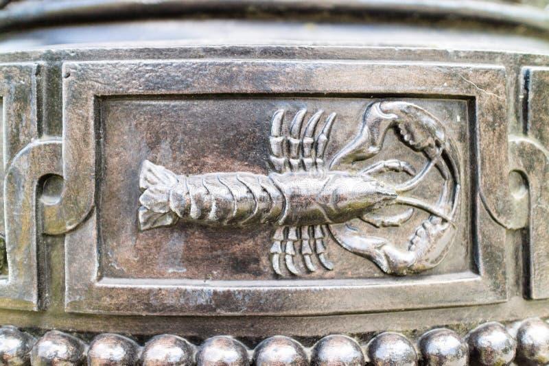 Skorpion i metall royaltyfri fotografi