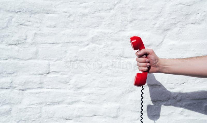 Skott av en landlinetelefonmottagare med kopieringsutrymme för indivi royaltyfri foto