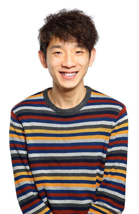 Skott för leende för ungt asiatiskt manslut övre royaltyfri fotografi