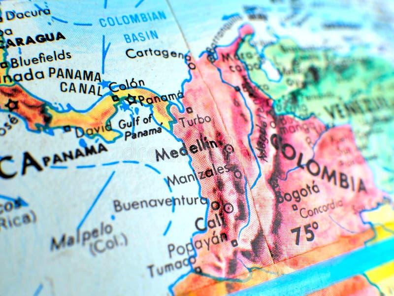Skott för Medellin Colombia fokusmakro på jordklotöversikten för loppbloggar, socialt massmedia, websitebaner och bakgrunder royaltyfri foto