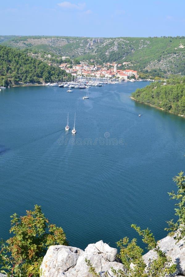 Skradin town in Dalmatia, Croatia. Vertical panoramic view of seaside town Skradin and National Park Krka River from above; Croatia, Europe royalty free stock image