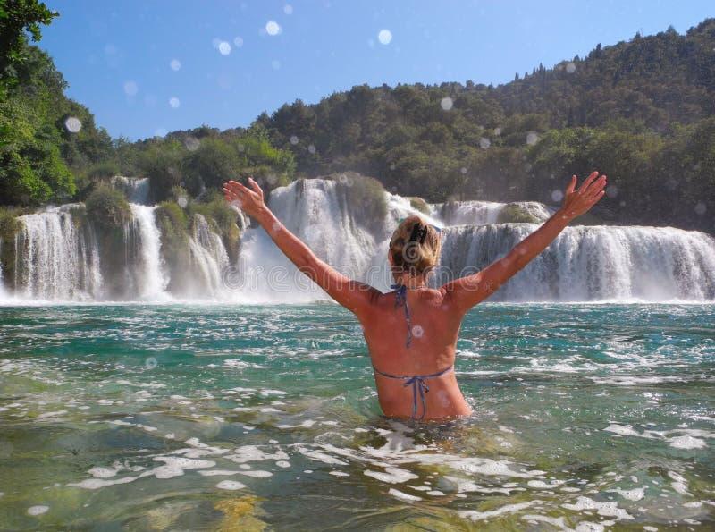Skradinski buk, Croatia. The girl near the waterfall Skradinski buk, Croatia