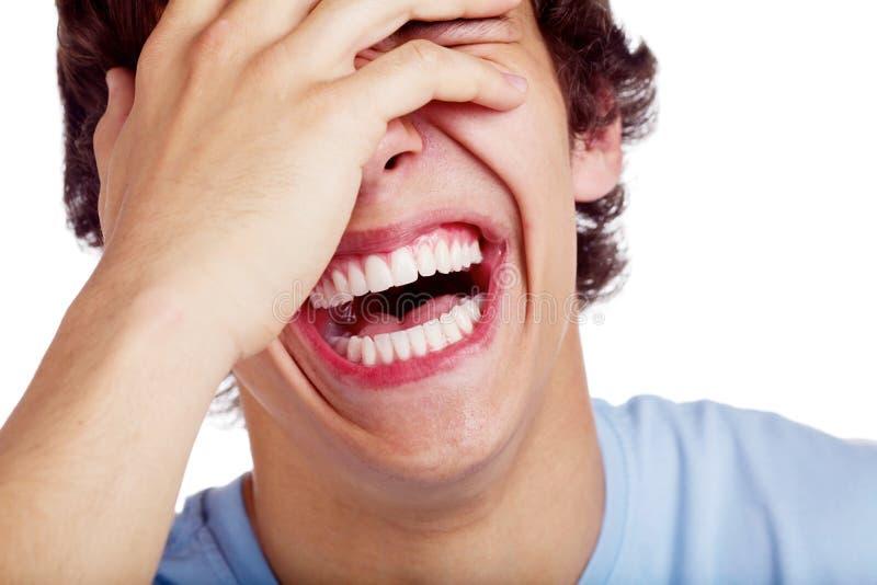 Skratta grabbcloseupen arkivbild