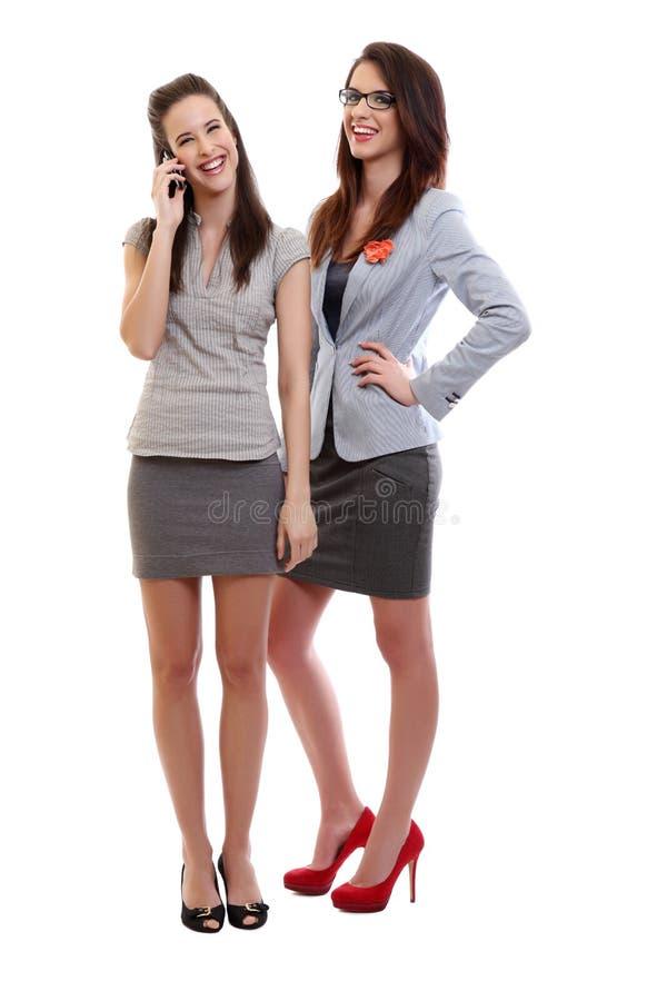 skratta kvinnor för affär royaltyfria bilder