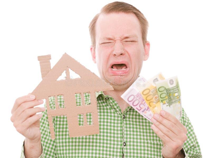 Skriande houseowner med pengar royaltyfri foto