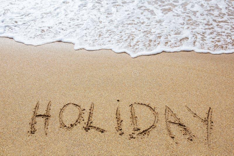Skriftlig ferie i sand royaltyfria foton