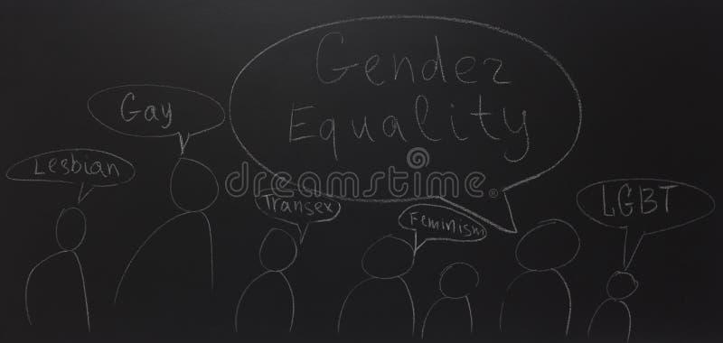 Skriftlig text med krita på svart tavla: Jämställdhet fotografering för bildbyråer