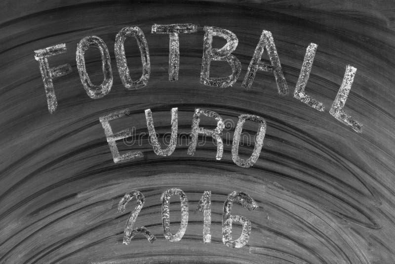 Skriftligt fotbolleuro 2016 på en använd svart tavla arkivfoto