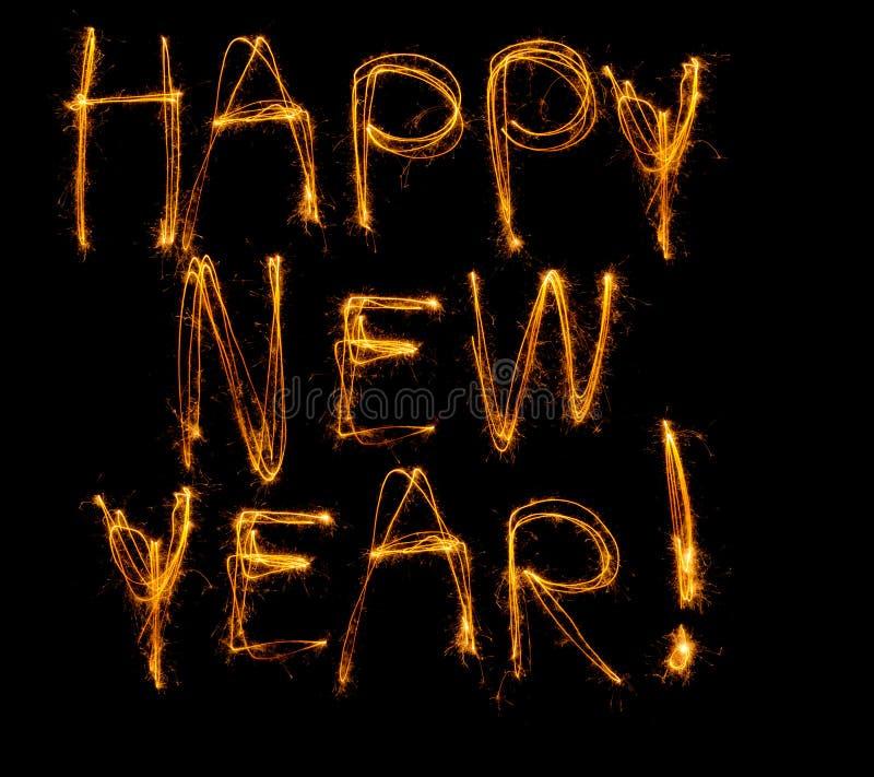 Skriftligt lyckligt nytt år i sparklers royaltyfria bilder
