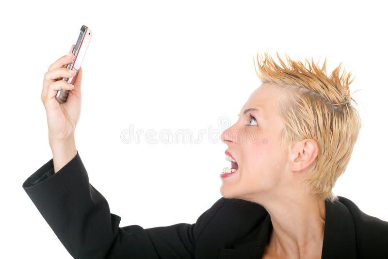 skrika för affärstelefonkvinna arkivfoto