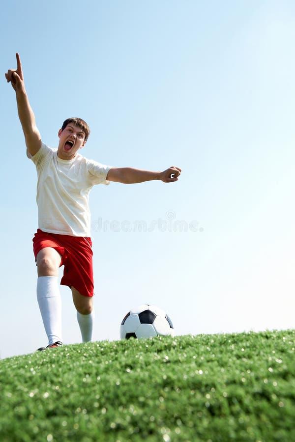 skrika för footballer royaltyfri fotografi