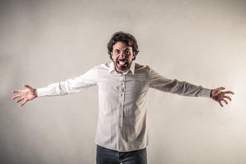 Skrikig Man Med öppnade Armar Fotografering för Bildbyråer