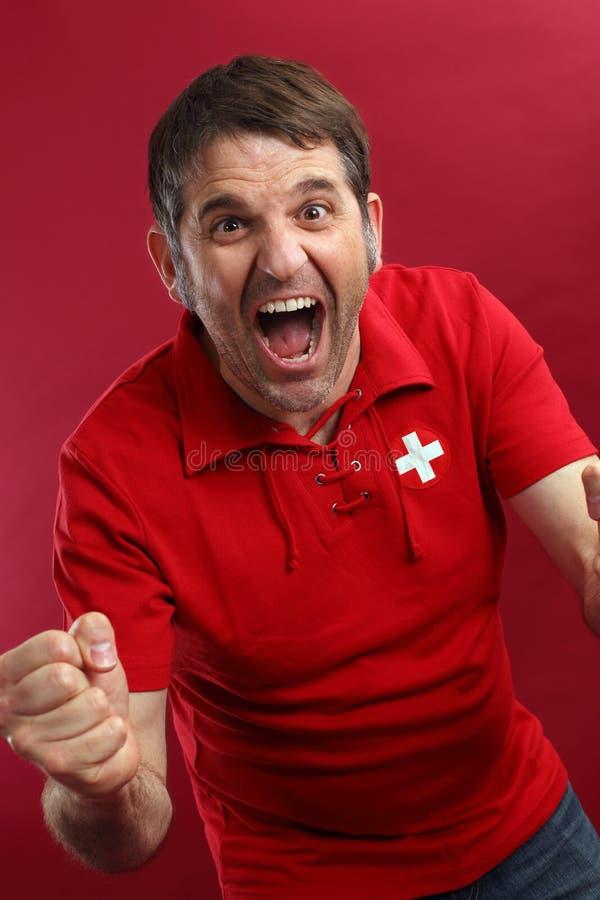 Skrikig schweizisk sportventilator royaltyfria bilder