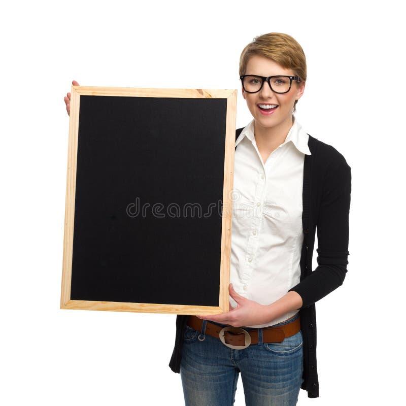 Skriv ditt meddelande på svart bräde. arkivfoto
