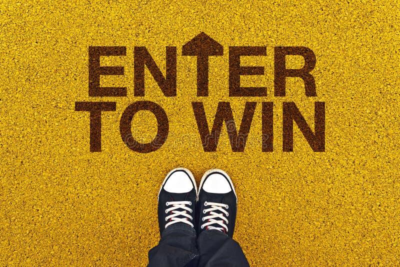 Skriv in för att segra på Asphalt Road royaltyfri fotografi