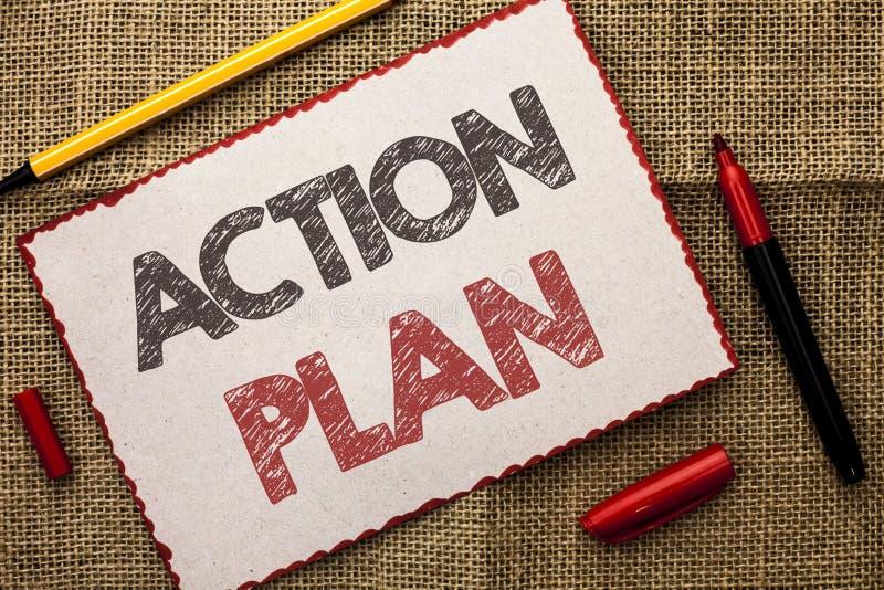 Skriva anmärkningsvisninghandlingsplanen Affärsfoto som ställer ut för planläggningstillvägagångssätt för strategi fungerande wri arkivfoto