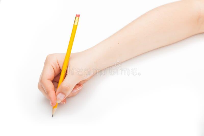 Skriva med en blyertspenna royaltyfri foto