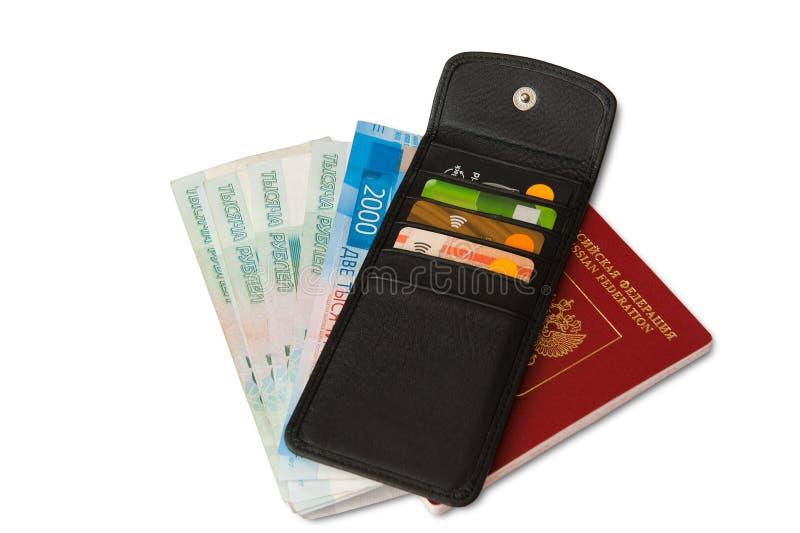 Skrivbord av den vanliga handelsresanden - vinkelsikt Sammansättningen av nödvändiga objekt för tur: pass med stämplar för åtskil royaltyfria foton