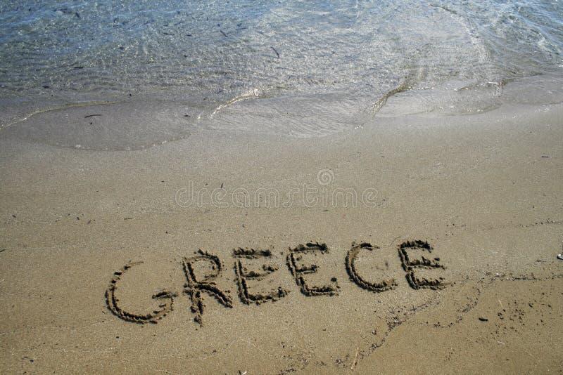 skriven greece sand arkivfoto