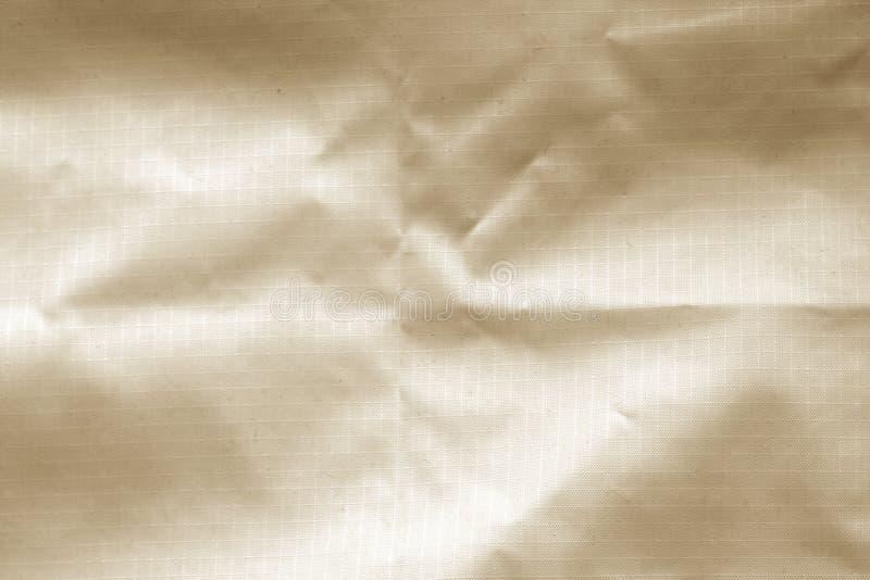 Skrynklig genomskinlig plast- yttersida i brun f?rg royaltyfri foto