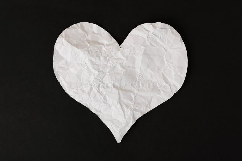 Skrynklig pappers- hjärta royaltyfria foton
