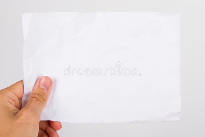 Skrynkligt papper för hand innehav royaltyfria foton
