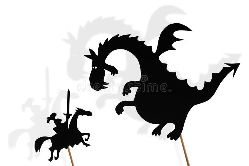 Skuggadockor av draken och riddare royaltyfri foto