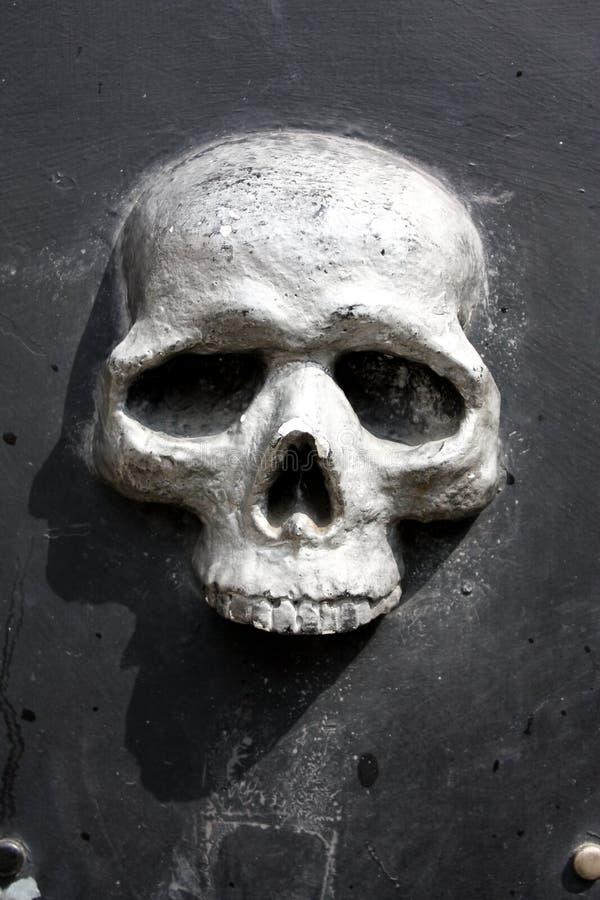 Skull. Metal skull door, fishing district of Genoa, Italy stock photos