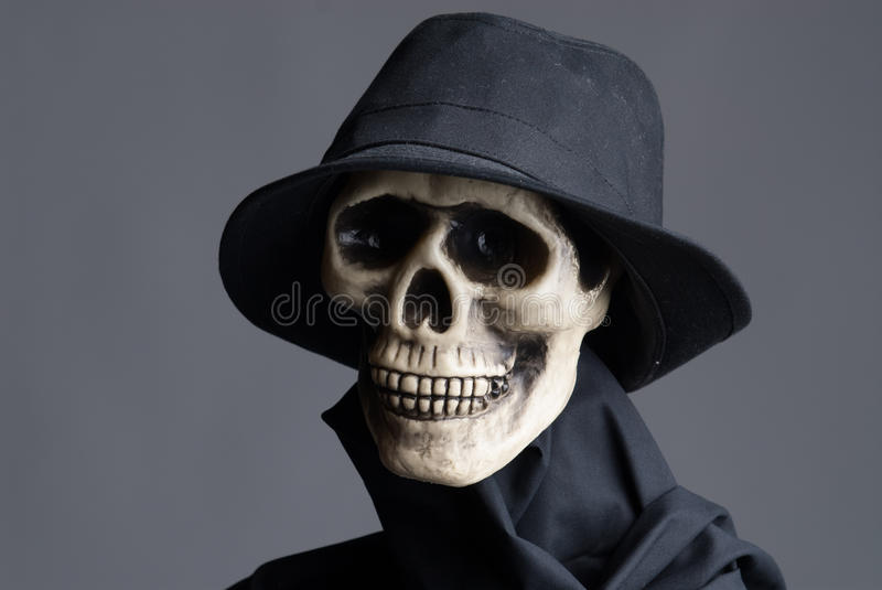 Skull in black hat and coat. Portrait of a skull in black hat and coat royalty free stock images